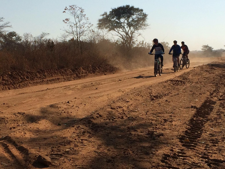 We road mountain bikes and endured the dust and dirt of the dry winter season in Zambia.