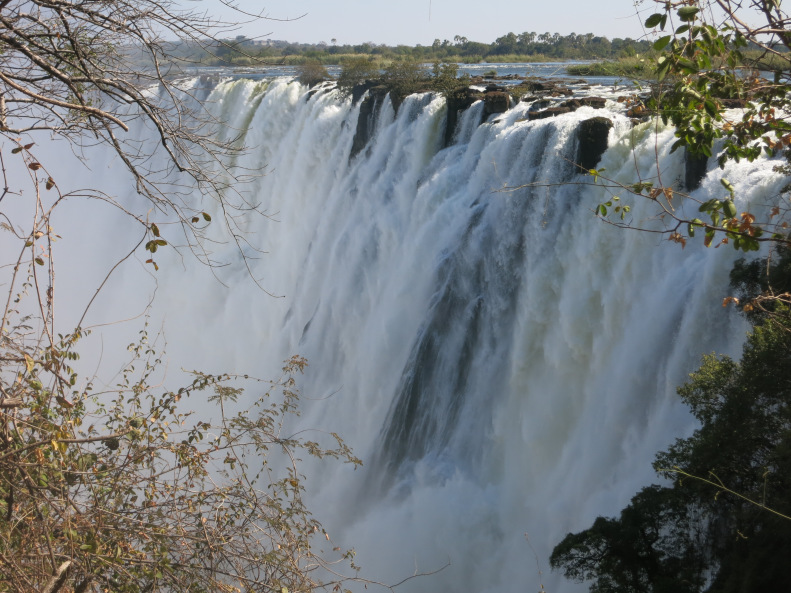 The mighty Victoria Falls overflowing with water from the summer rains.