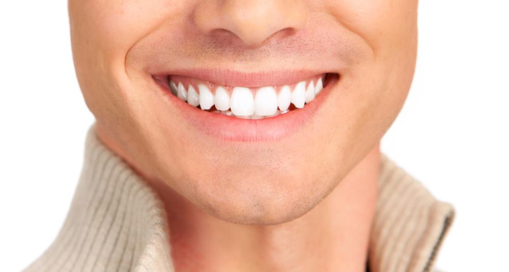 shutterstock-man-smile-closeup-white-teeth.jpg