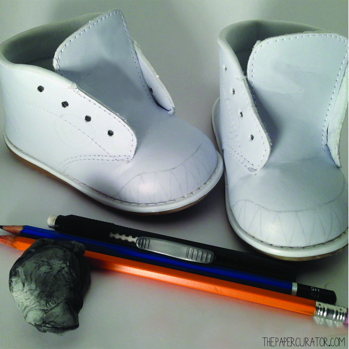 USE YOUR PENCIL AND SKETCH THE DESIGNS YOU WANT TO PAINT ONTO BOTH SHOES.