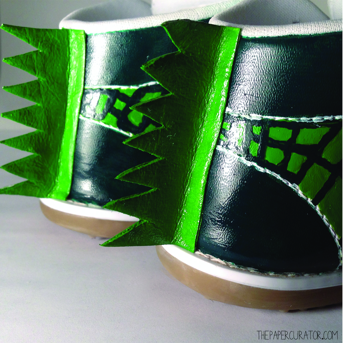 FINISHED FINS APPLIED WITH CRAFT AND FABRIC GLUE TO THE BACK OF THE FINISHED SHOES.