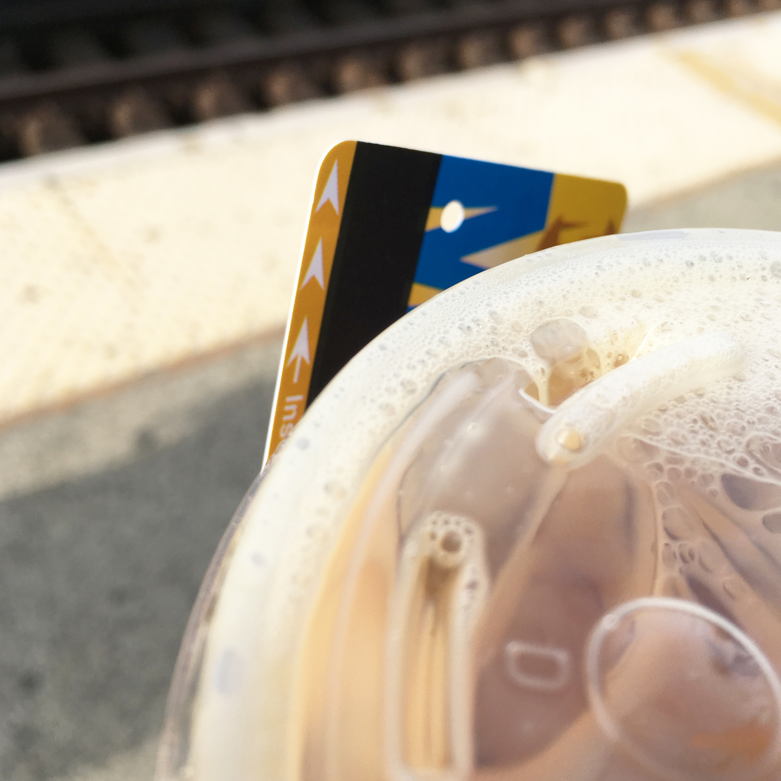 Coffee and metro card in hand - always on the go