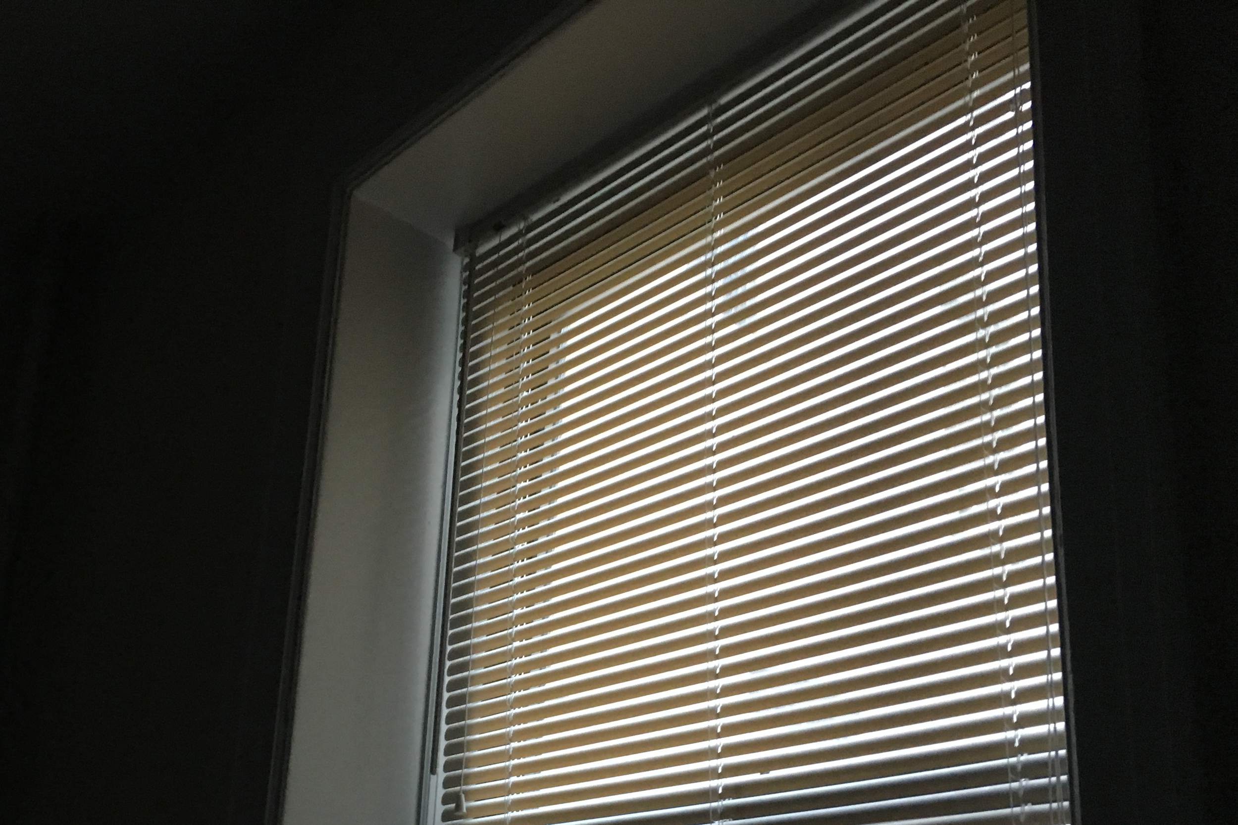 V still sleeping means getting dressed in the dark with just these slivers of light coming through the window