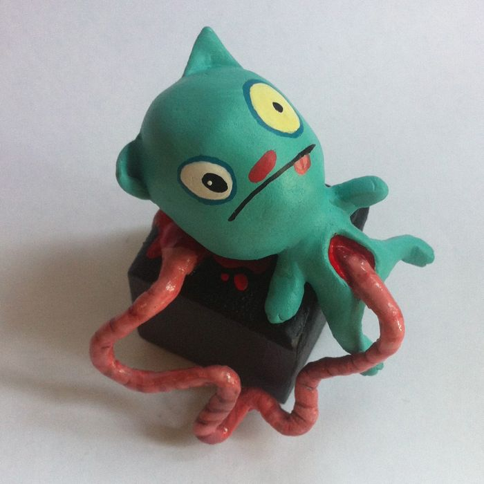Based off of a plush I made years ago.  Paperclay, acrylic paint, wood, wire, foil and gloss varnish (for 'juicy' effect)