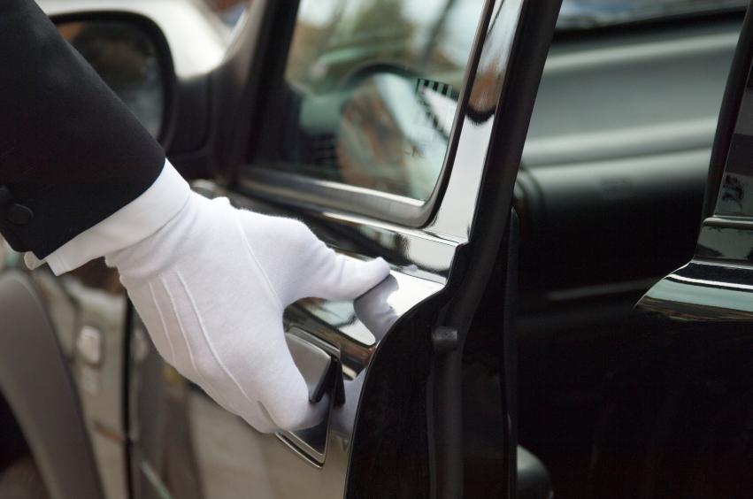 white gloved hand opening car door for customer.jpg