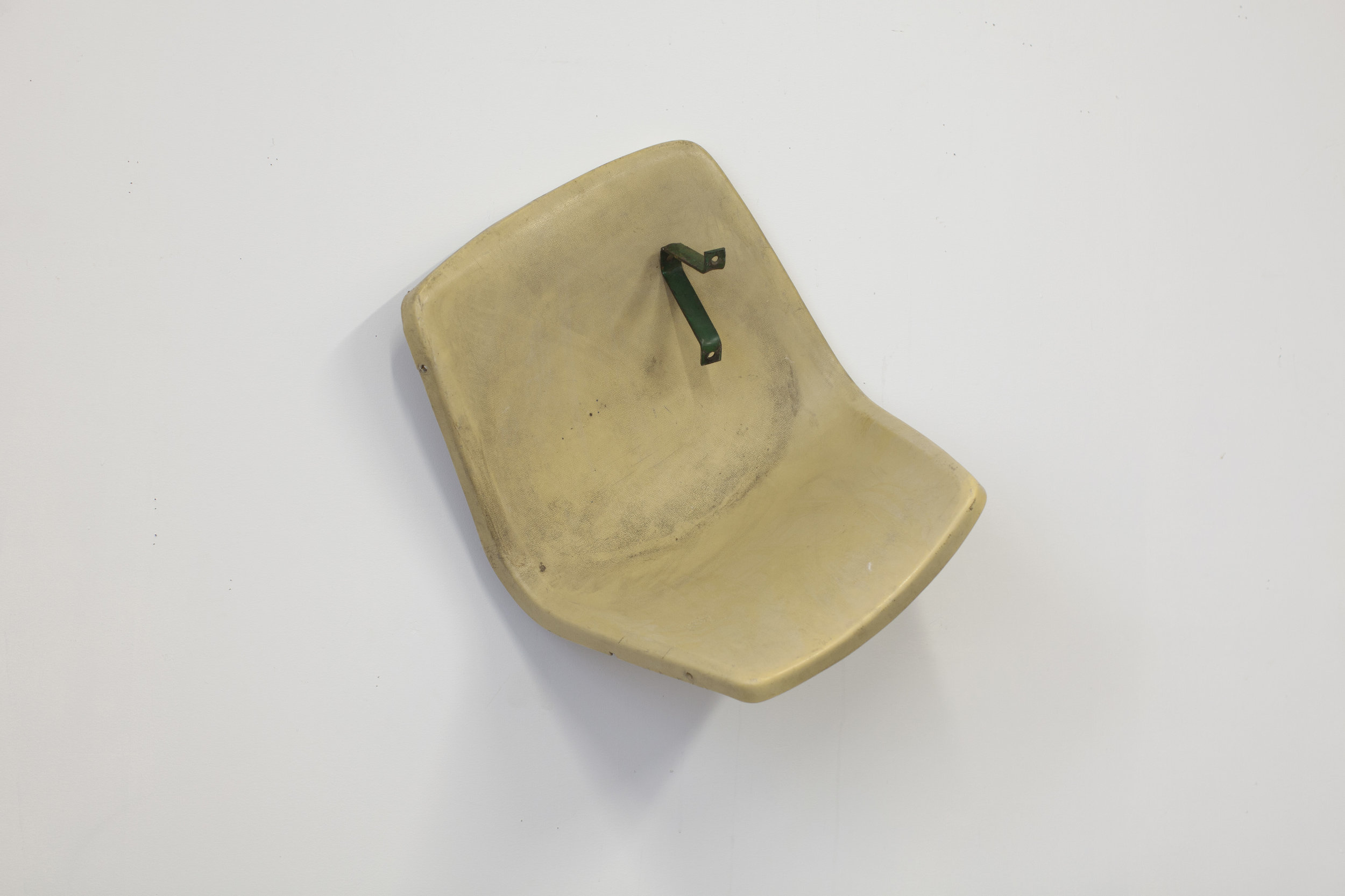 RSRVD | Found plastic seat, metal and magnet, 2018