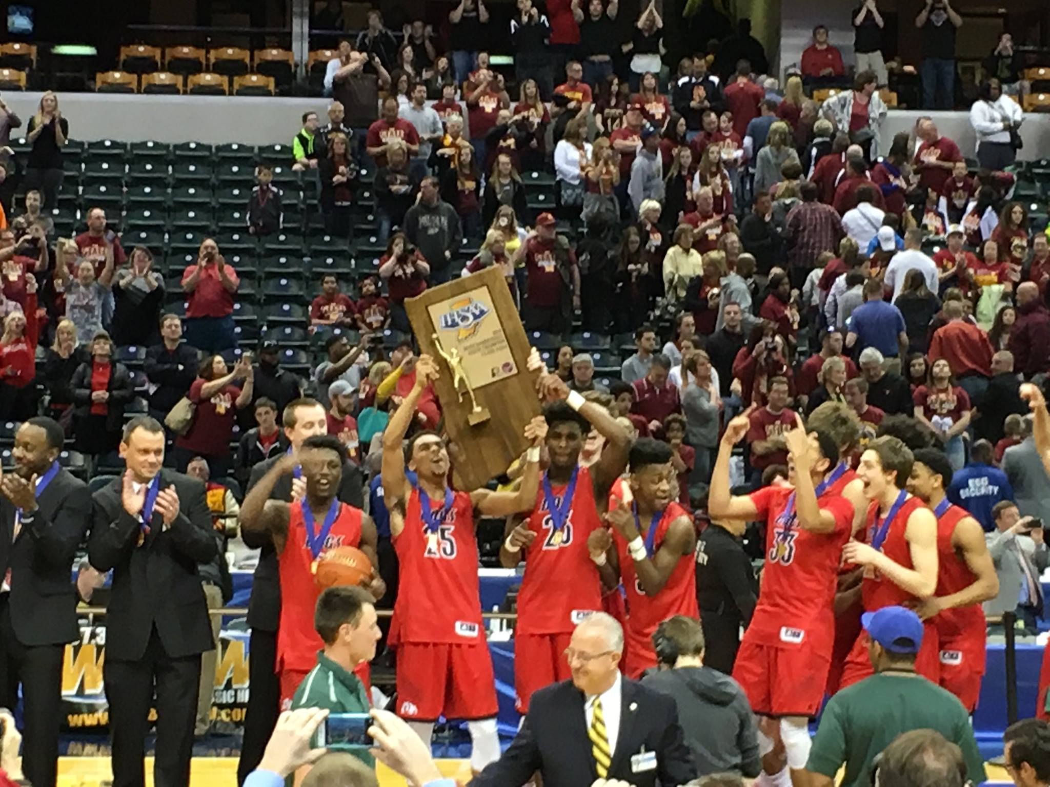 The Bulldogs hold up their first state championship since 1973.