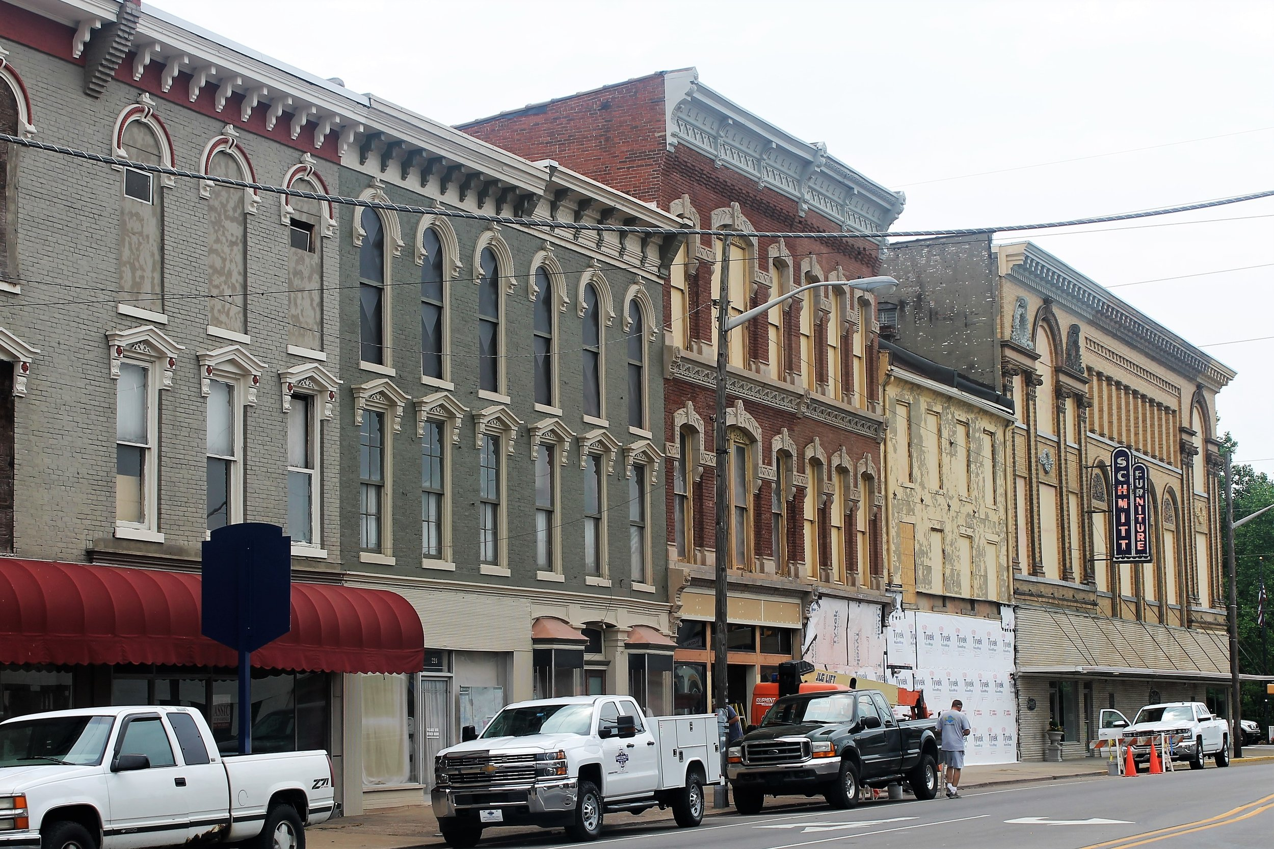 Work is underway at Schmitt Furniture to remove the old paint and improve the facades of multiple buildings along State Street.