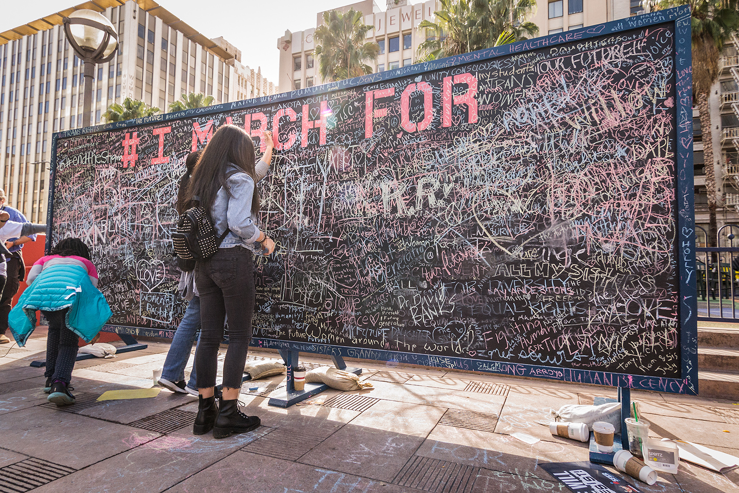 (2017) Hashtags like #IMarchFor, #WomensMarch and #WomensMarchLA are used on social media to crowd source reasons people in Los Angeles and around the world supported the Women's March on Washington and its sister cities' marches.