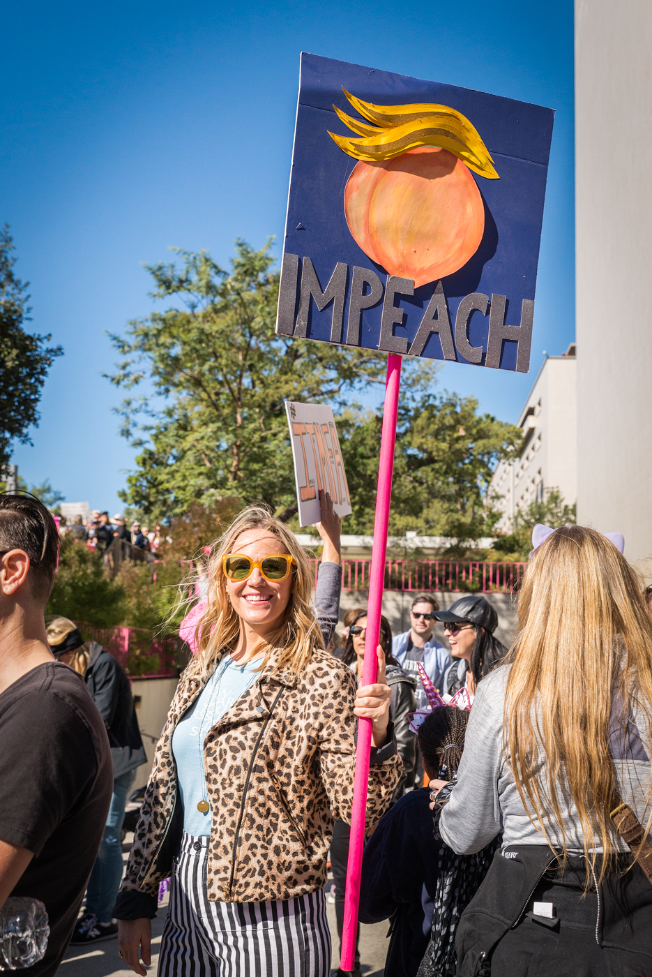 (2018) The peach is back - hair and all. Calls for impeachment are strong at the march.