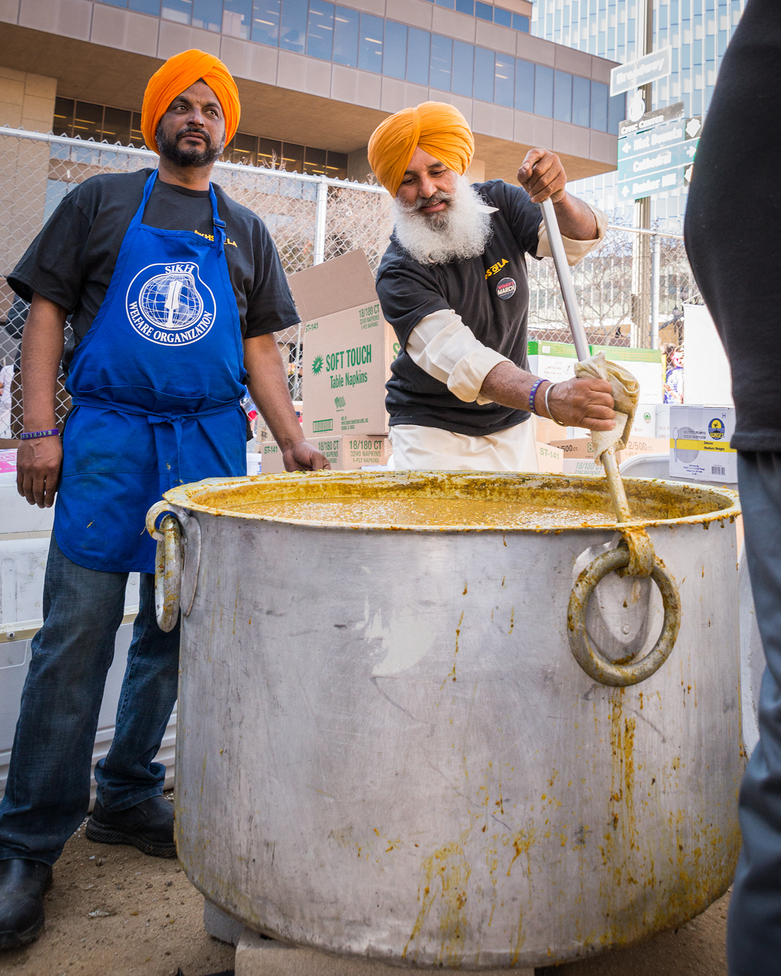 (2018) The Sikhs of LA return for the second Women's March to give out free chana masala, or savory chickpeas, and white rice. The demand for food is great so the curry-like dish is scooped from the cauldron by the bucket - literally.