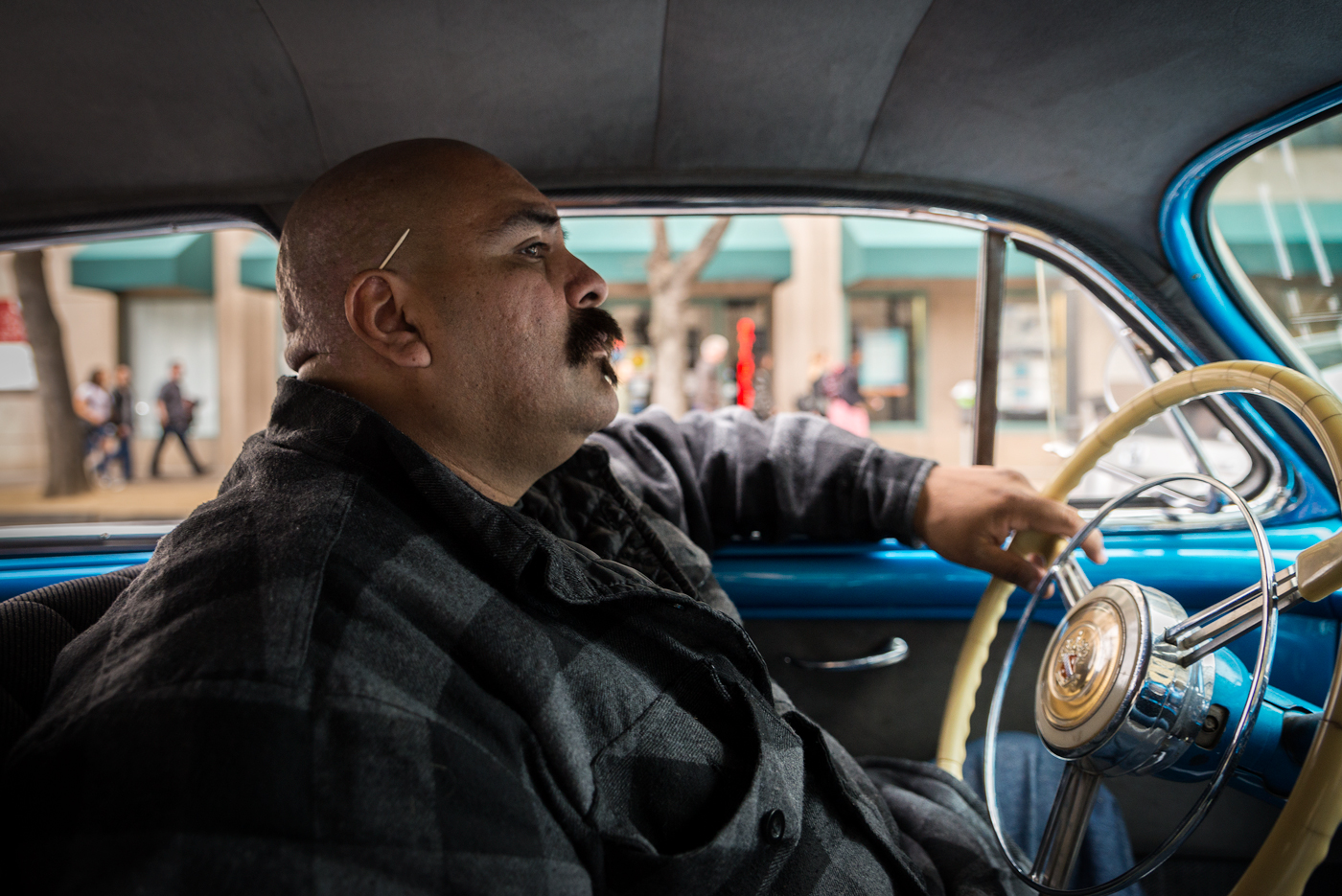 Carlos Rodriguez cruises his 1947 Buick Super - one of three lowriders his family owns. Rodriguez has been lowriding for the last 12 years. Though he did not grow up lowriding, he is determined to make the activity an integral part of his children's lives.  ARASE /PHOTOGRAPHING 'SLOW AND LOW'