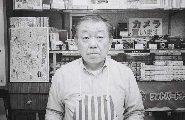 S N A P  # 2 •  The man who sold the world. (Or in this case a camera.) •  #ricohFF1 #35mm #streetphotography #kanazawa #japan #precision #tri-x #film #photography #artseries #artordie