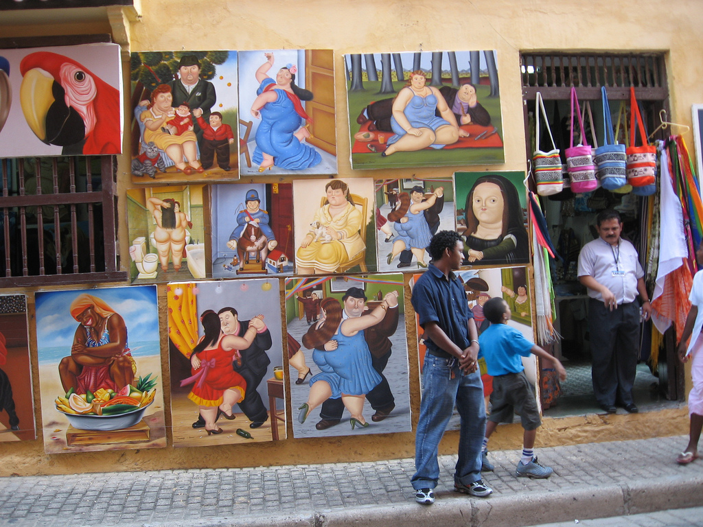 A shop with depictions of many Fernando Botero paintings. Botero is one of the most famous Colombian artists. By ho visto nino volare. Available  here .
