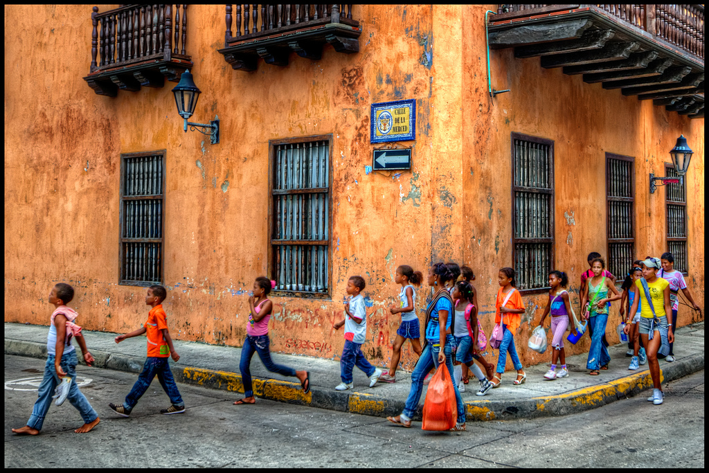 Children walking in Cartagena de las Indias, Colombia. By Pedro Szekely. Available  here .