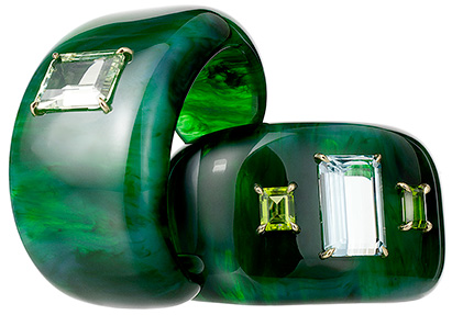 Hand-carved cuffs of vintage bakelite with prong-set heliodor, aquamarine and peridots in 18 karat gold.
