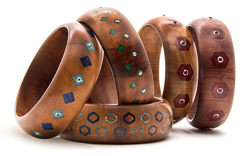 Wooden bangles inlaid with vintage bakelite and set with colored gemstones mounted in 18 karat gold.