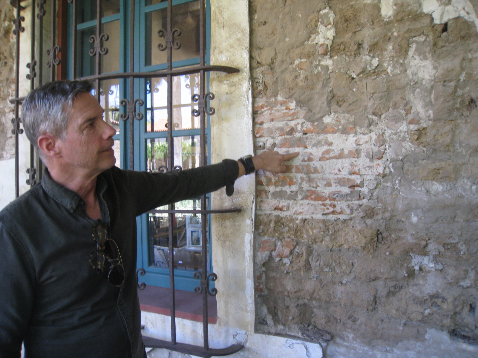 Project conservator John Griswold discusses mix of underlying building materials.