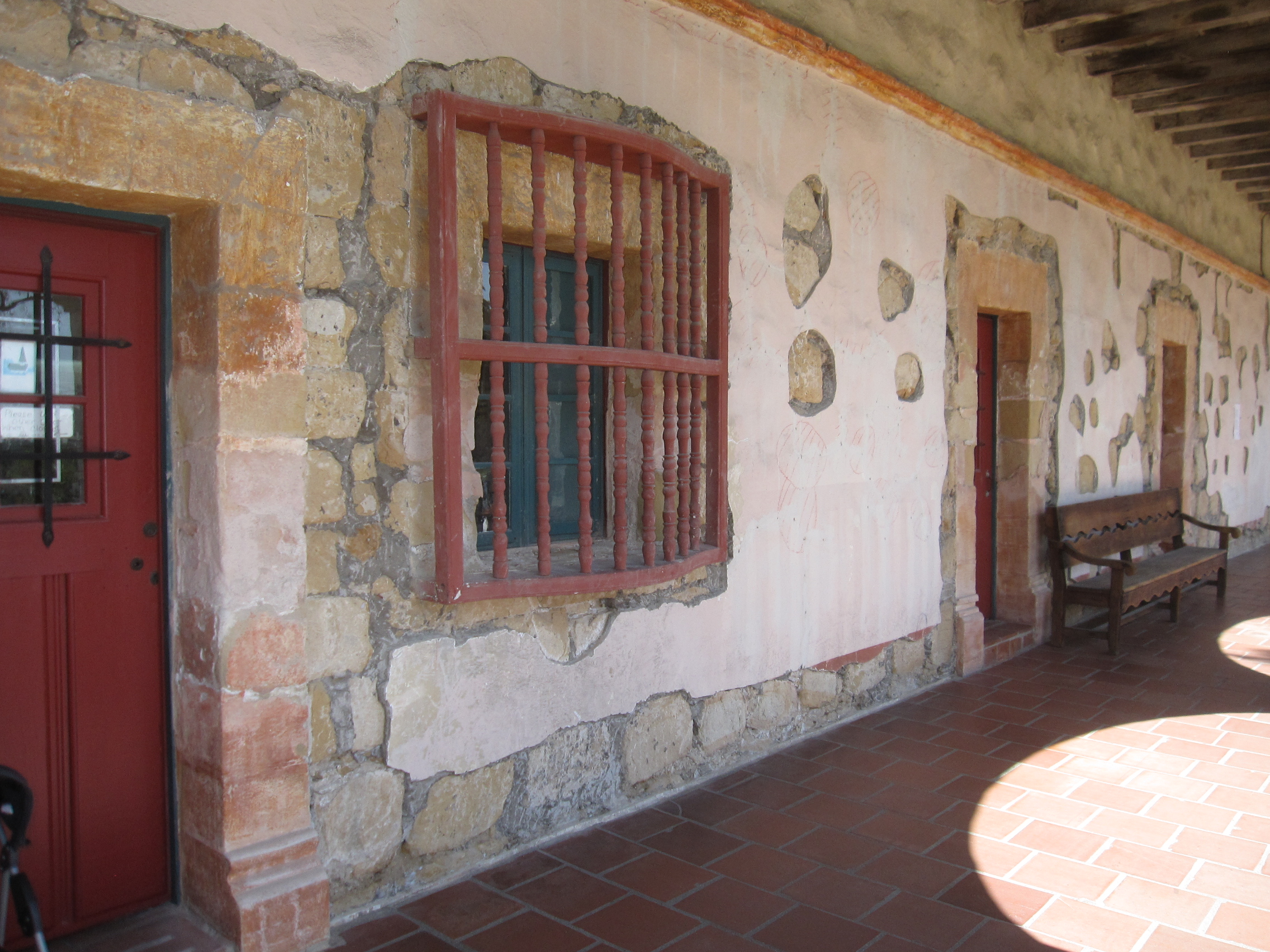 """Convento wing south elevation with """"windows"""" showing underlying sandstone."""