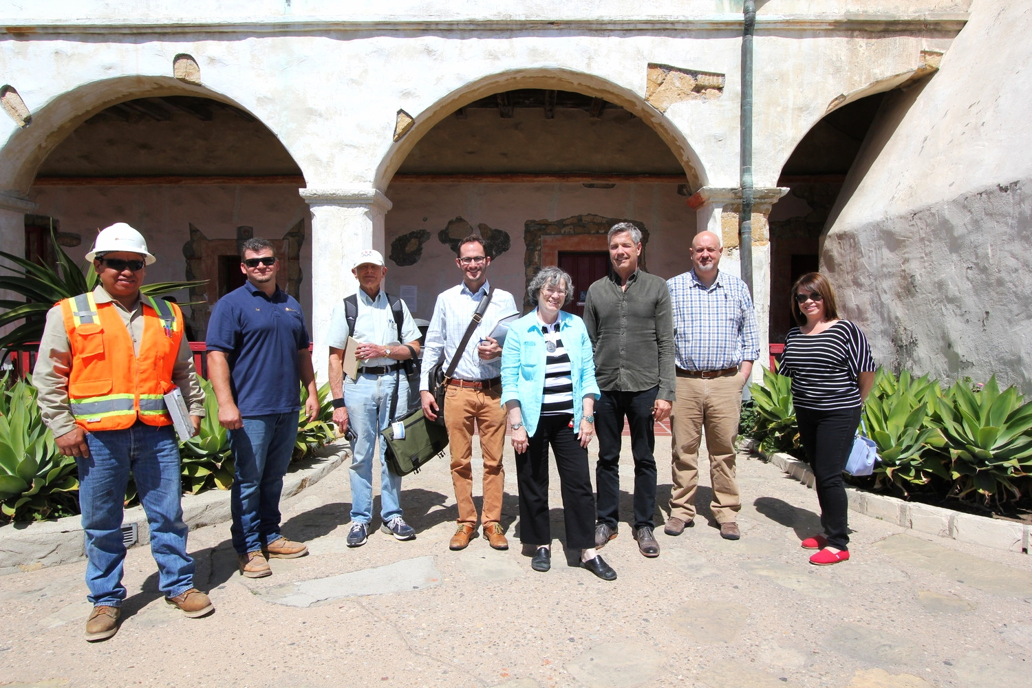 Project team members in front of the  convento  wing south elevation. From left: Napoleon Gallardo (Spectra), Troy Parry (Spectra), Nels Roselund (Roselund Engineering), Shane Swerdlow (Chattel), Tina Foss (Old Mission Santa Barbara), John Griswold (Griswold Conservation Associates), Brother Brian Trawick (Old Mission Santa Barbara), and Gabby Gonzalez (California Missions Foundation).