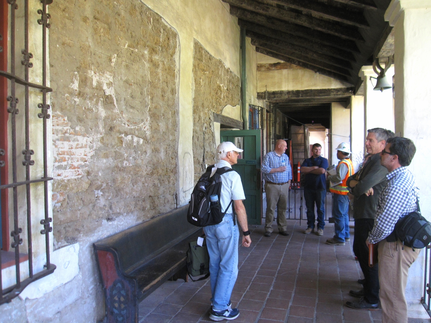 """Convento wing north elevation with """"windows"""" showing underlying building materials."""