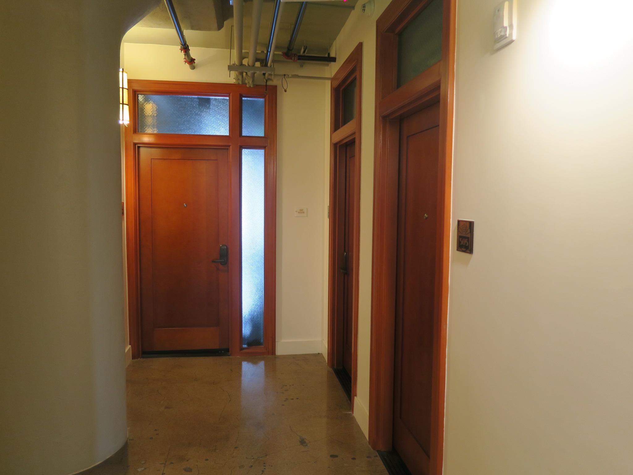Interior wood doors from corridor, after rehabilitation.