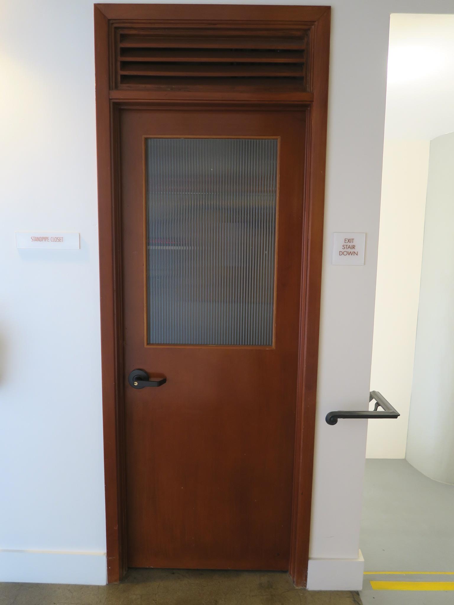 Original wood door at utility room.