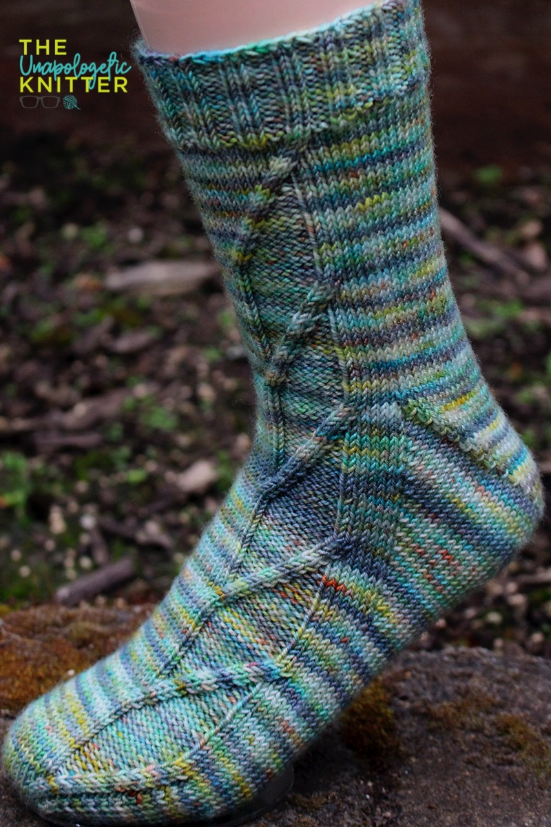 White Hart - Toe-up hand knit socks featuring a Fleegle heel and a traveling stitches pattern on the front of the sock