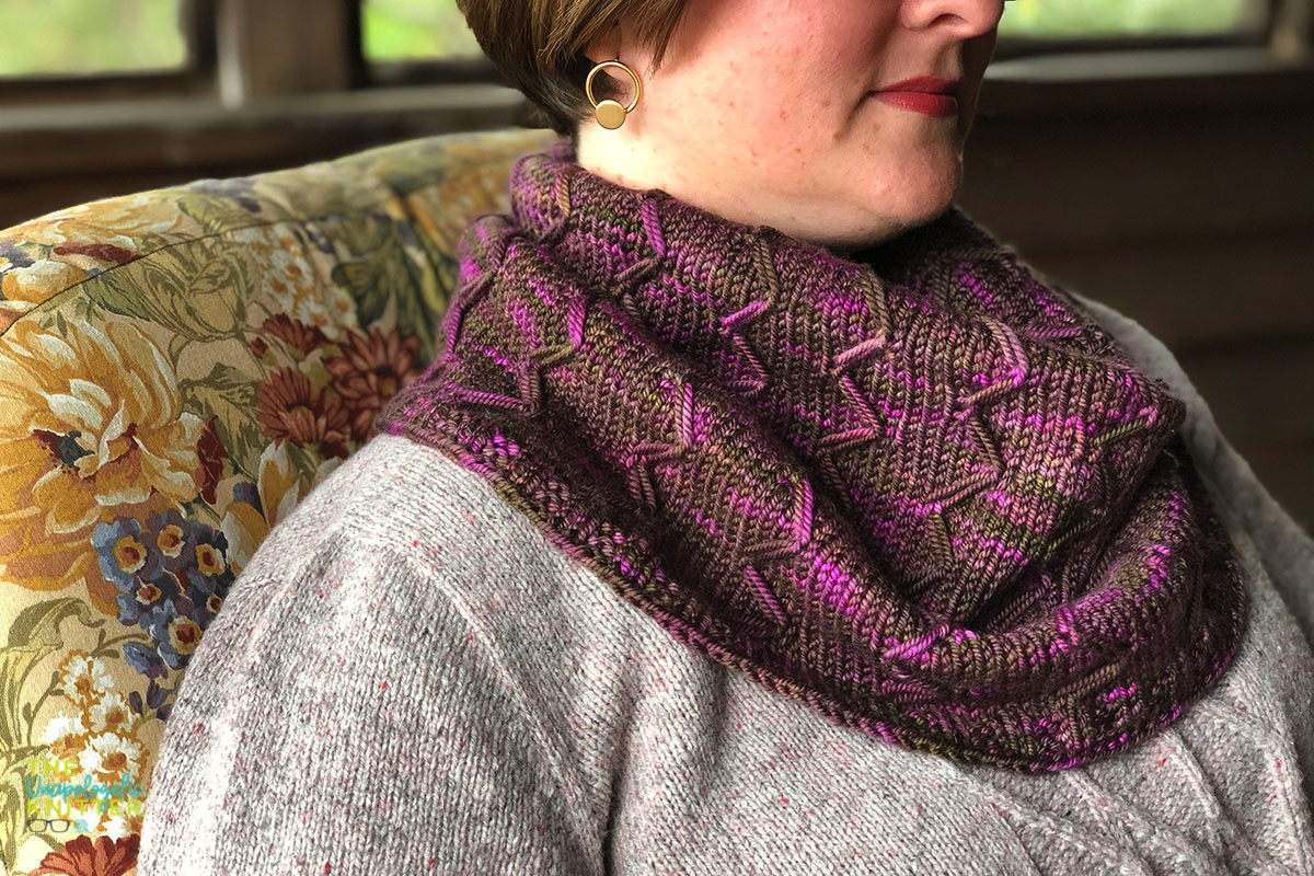 Cabin Rose - a worsted weight tapered cowl knit with graphic elongated stitches.