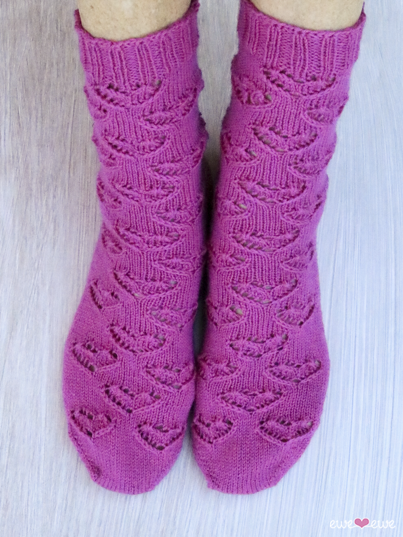 Ewe Heart Socks  (Ewe Ewe Yarns, featuring Fluffy Fingering): Do you love hearts as much as we do? Then you'll love the Ewe Heart Socks because they're covered in the sweetest eyelet lace hearts that mimic the Ewe Ewe Yarns heart logo.