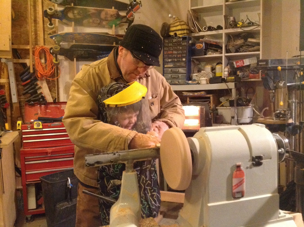 Mike O'Brien at home woodworking with his son.