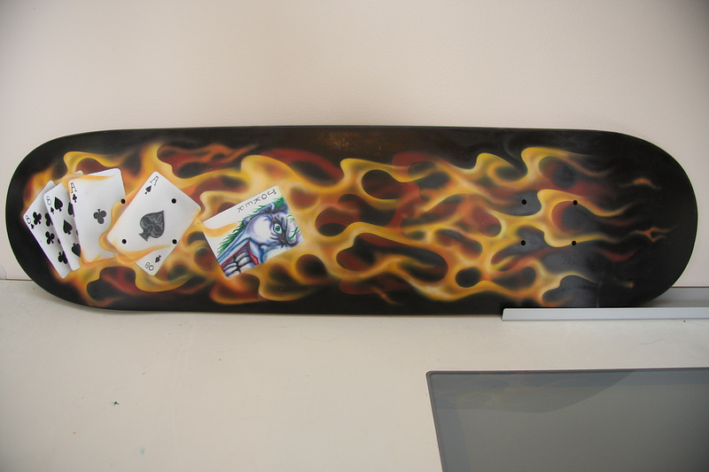 Fire and cards painted on a classic street shape