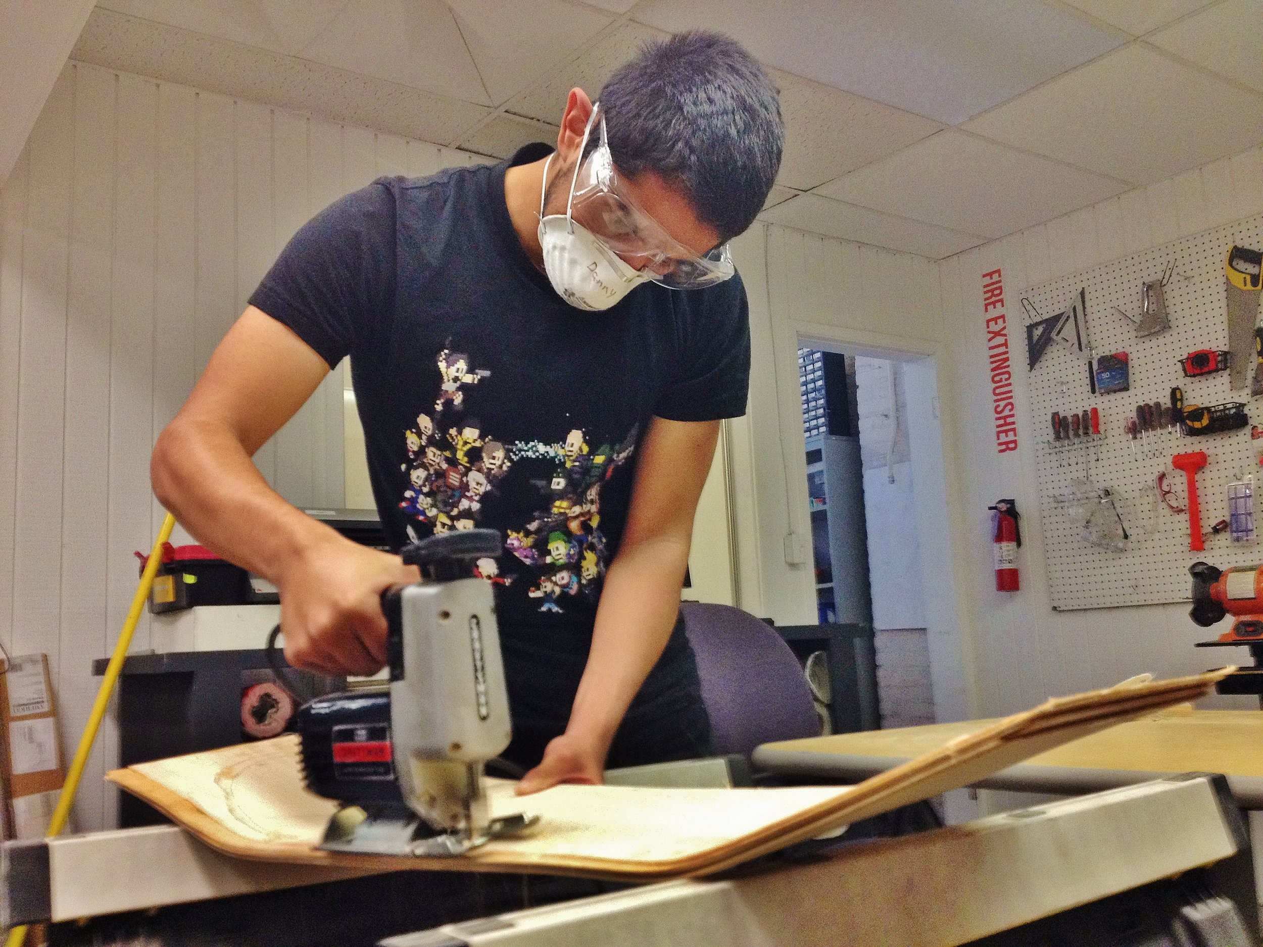 Open source student Danny cutting out a custom board to his liking.