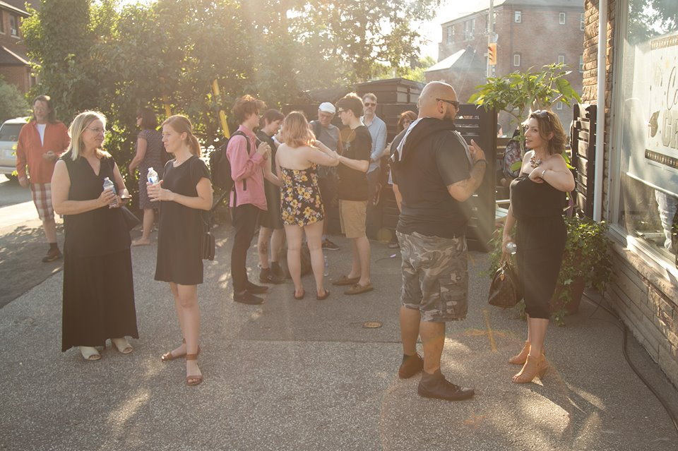 Parents, family and friends enjoying the hot summer evening outside
