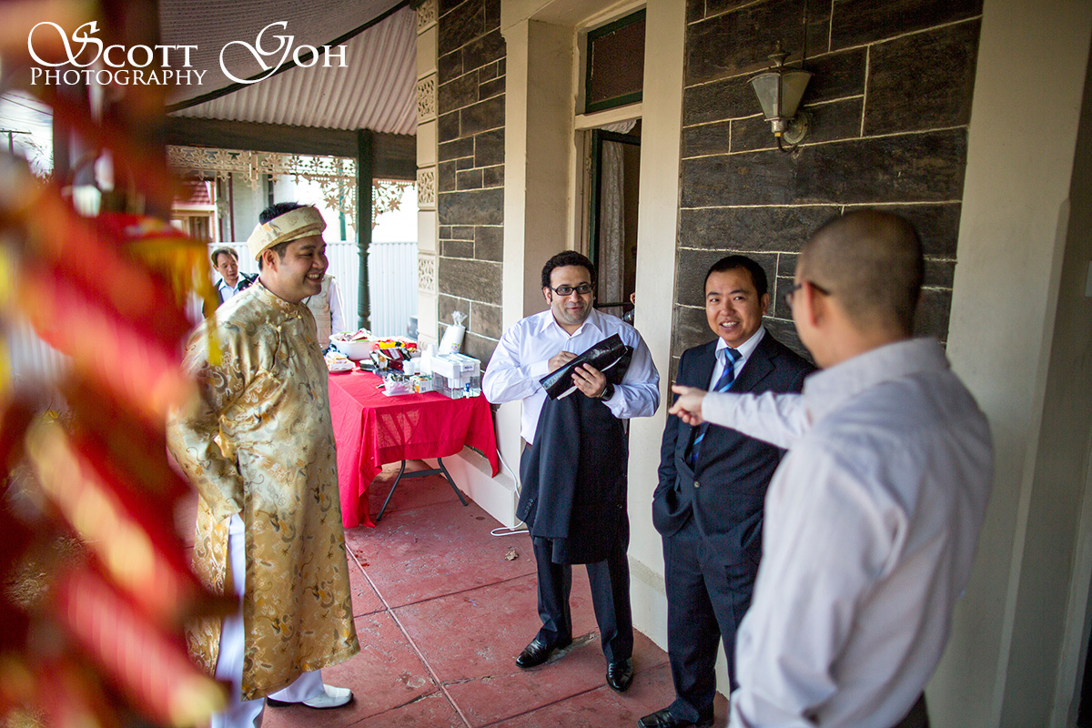 groom chatting in wedding