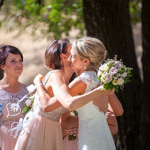 after wedding ceremony hugs