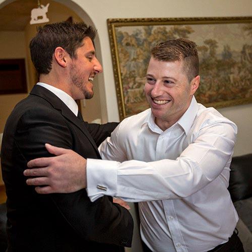 grooms hug wedding photo