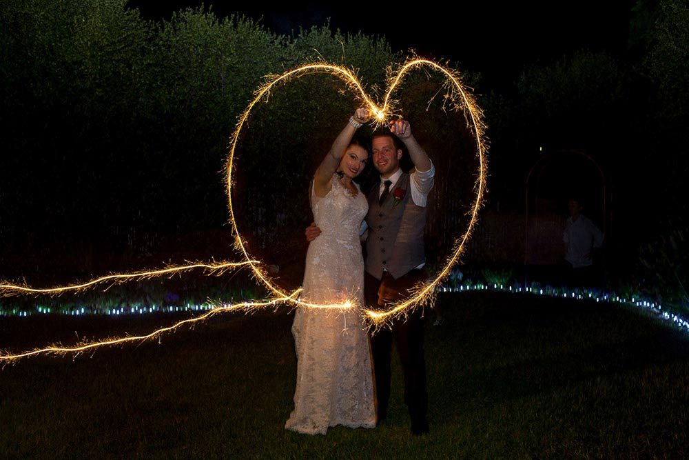 wedding couple night dark light trail photo