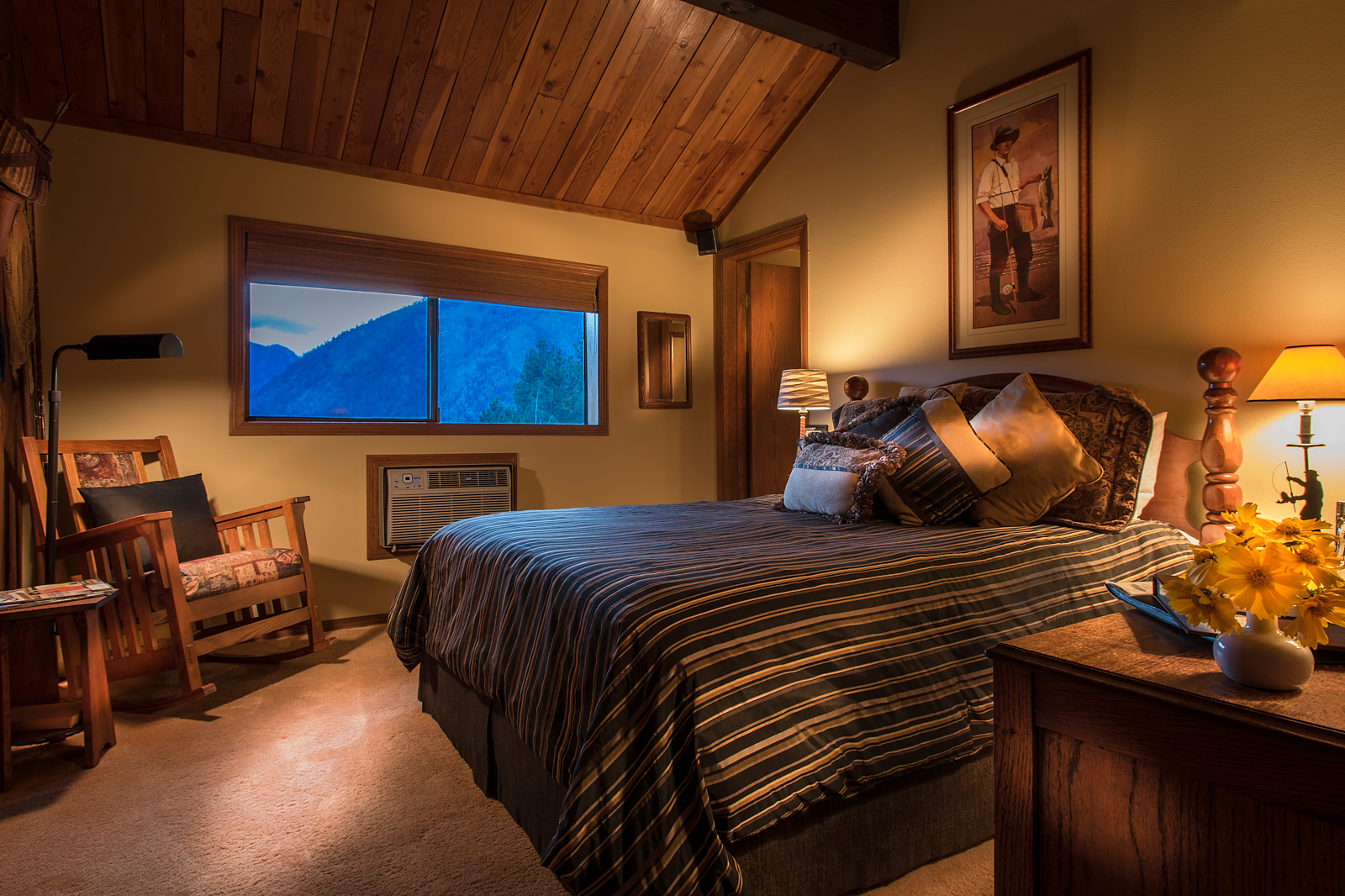 The Sportsman - A gorgeous view of the Cascades with a queen bed and vaulted pine ceiling.