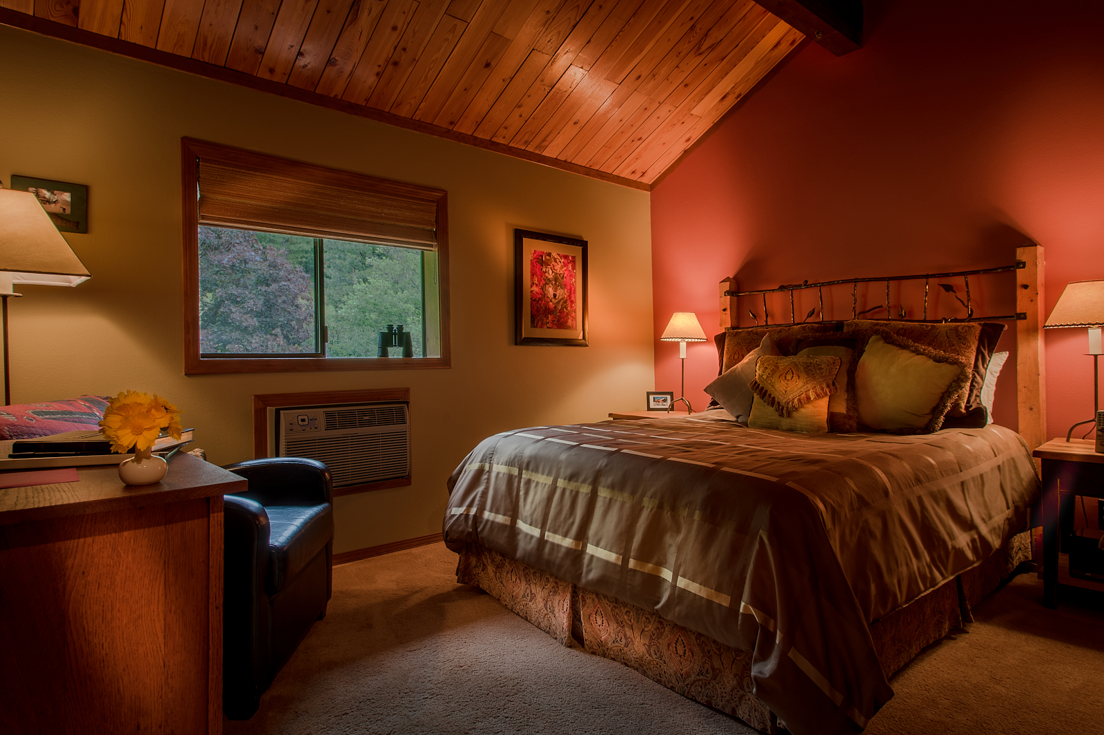 The Mountain Trout - Queen room with a vaulted ceiling and view of the meadow and upper forest.