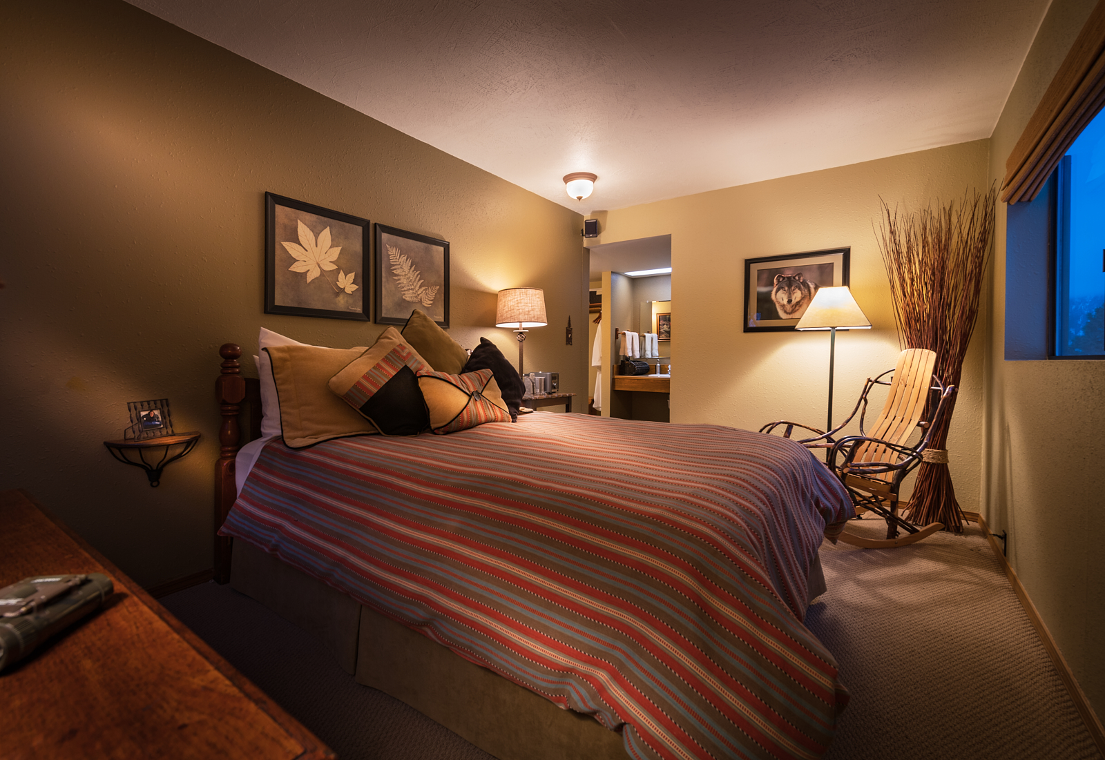 The Timberline - Cozy queen room with views of the forest and meadow.