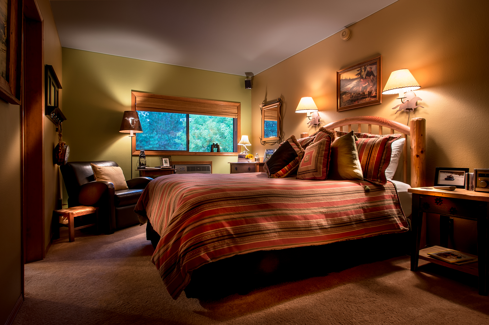 The Ranch - This queen bedroom offers a view of the forest.