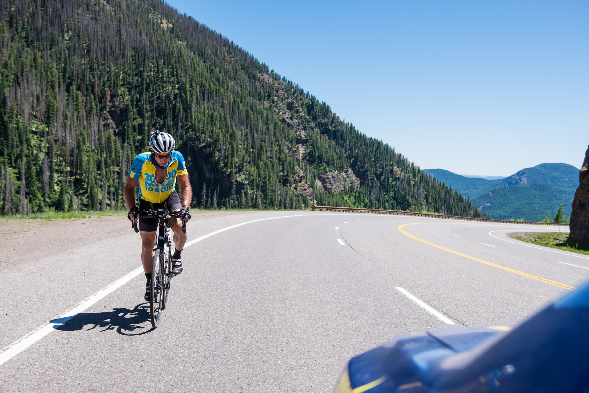 One of the more challenging parts of the race is the Wolf Creek Pass climb where cyclists have to climb up to 10,857 feet. The steep grade and lack of oxygen at such a high altitude make it difficult to get through. Marshall stands up to pedal through the pass on June 18th, 2016.