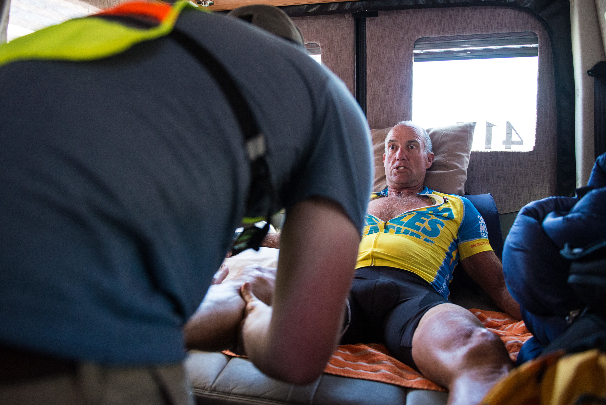 Cramps plagued Marshall through the first several days of the race as he tried to get throught he desert. The intense heat during the day and the frigid nights did not help the cause. Pictured is crew member Jacob Bouchard quickly massaging Marshall in his RV during a stop on June 15th, 2016.