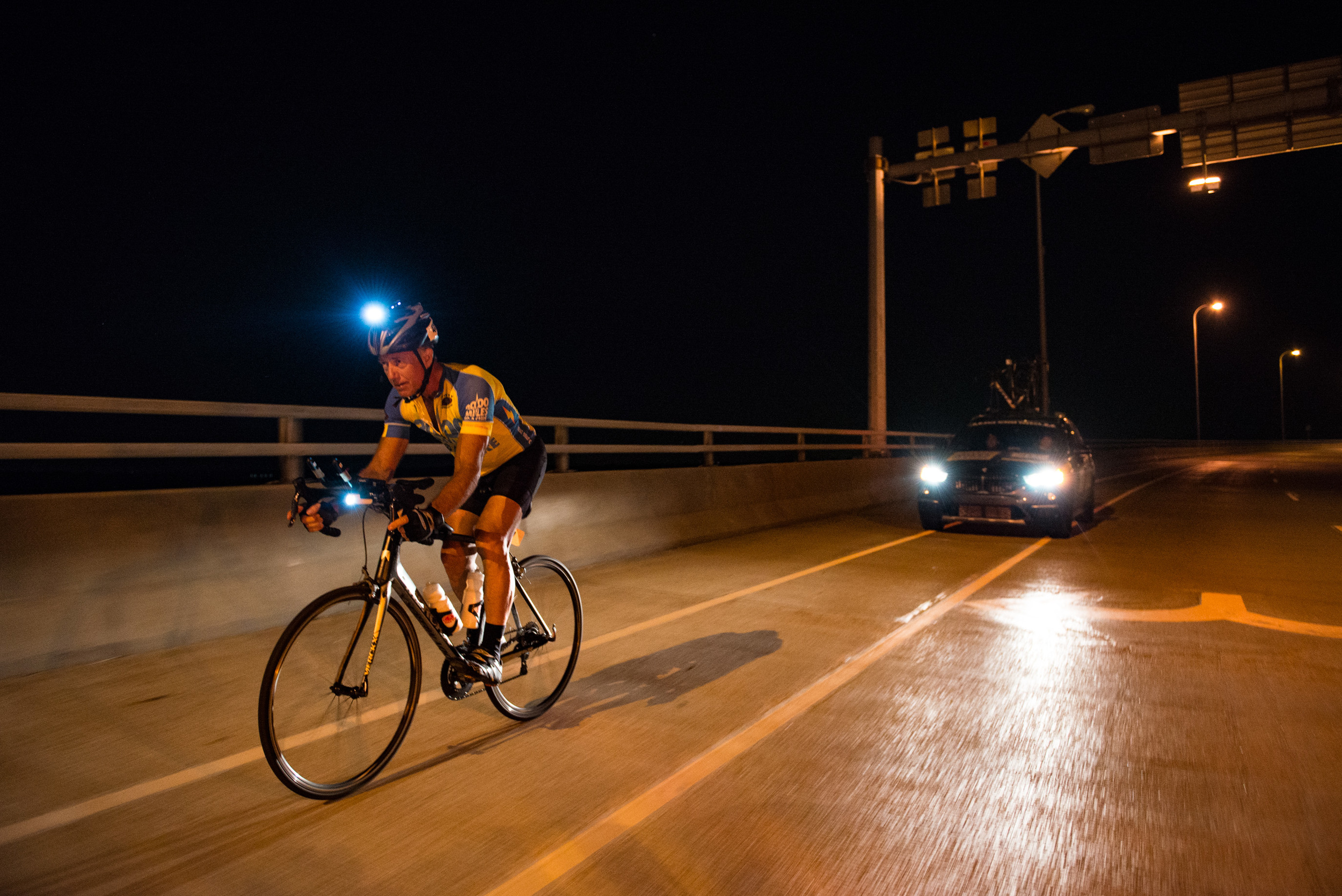 Marshall Reeves passes the Mississipi River bridge on the night of June 23rd, 2016, making the time cutoff. For many racers just getting to this point is a huge accomplishment because it represents completing two-thirds of the race.