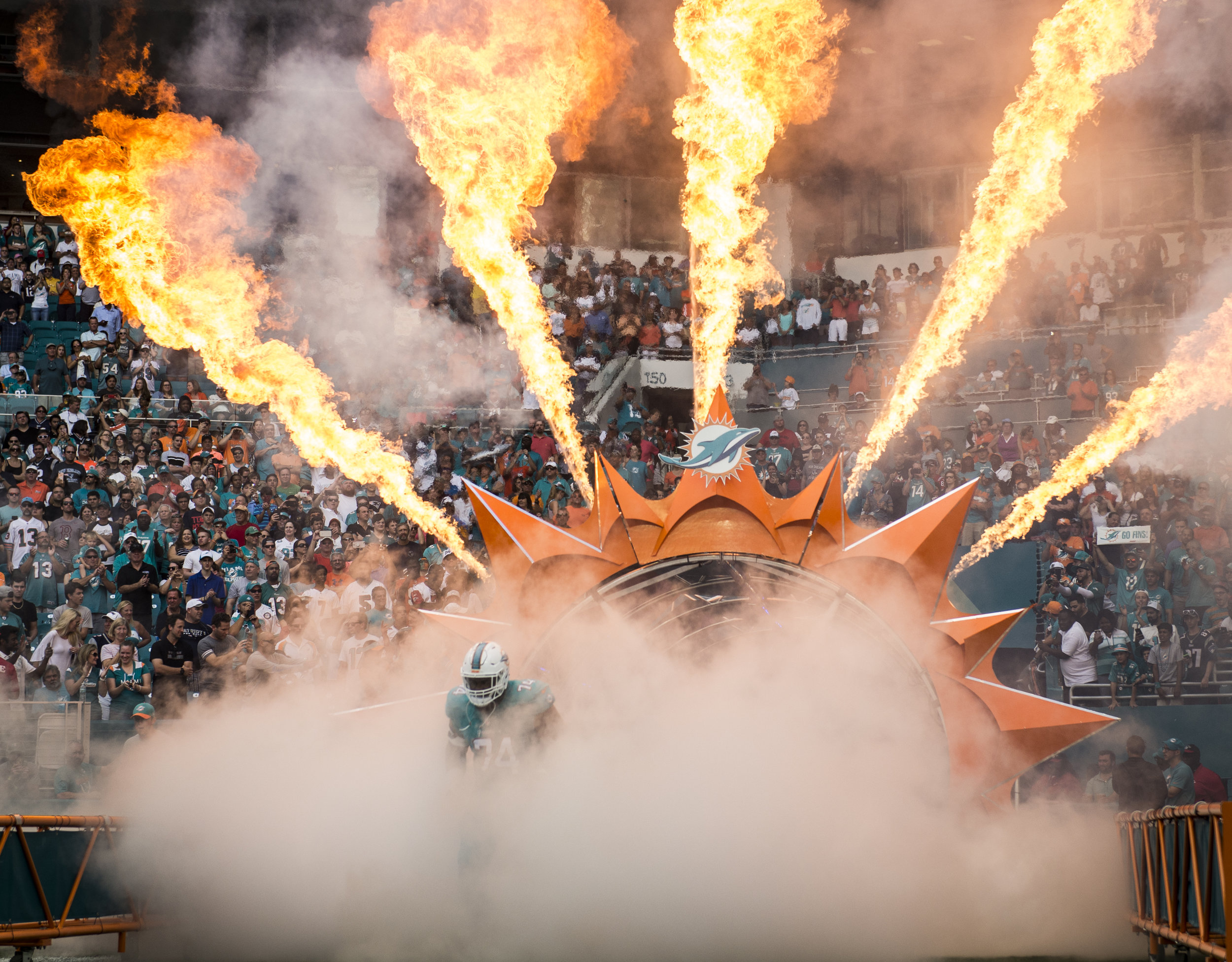 Miami Dolphins tackle Jermon Bushrod makes his entrance into the game versus the New England Patriots at Hard Rock Stadium in Miami Gardens, Florida, January 1, 2017.