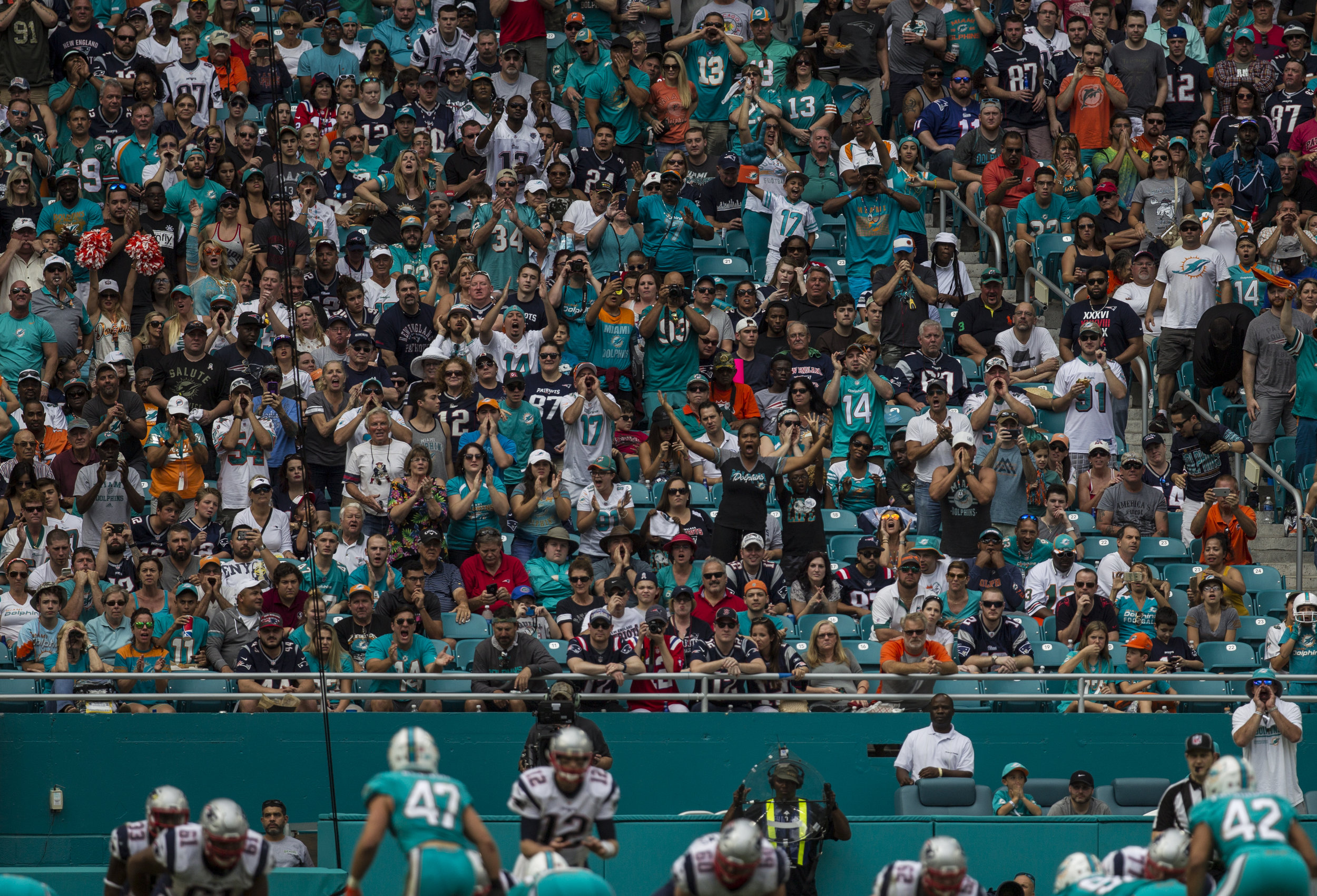 Miami Dolphins fans make some noise as New England Patriots quarterback Tom Brady (12) gets ready to snap the ball at Hard Rock Stadium in Miami Gardens, Florida, January 1, 2017.