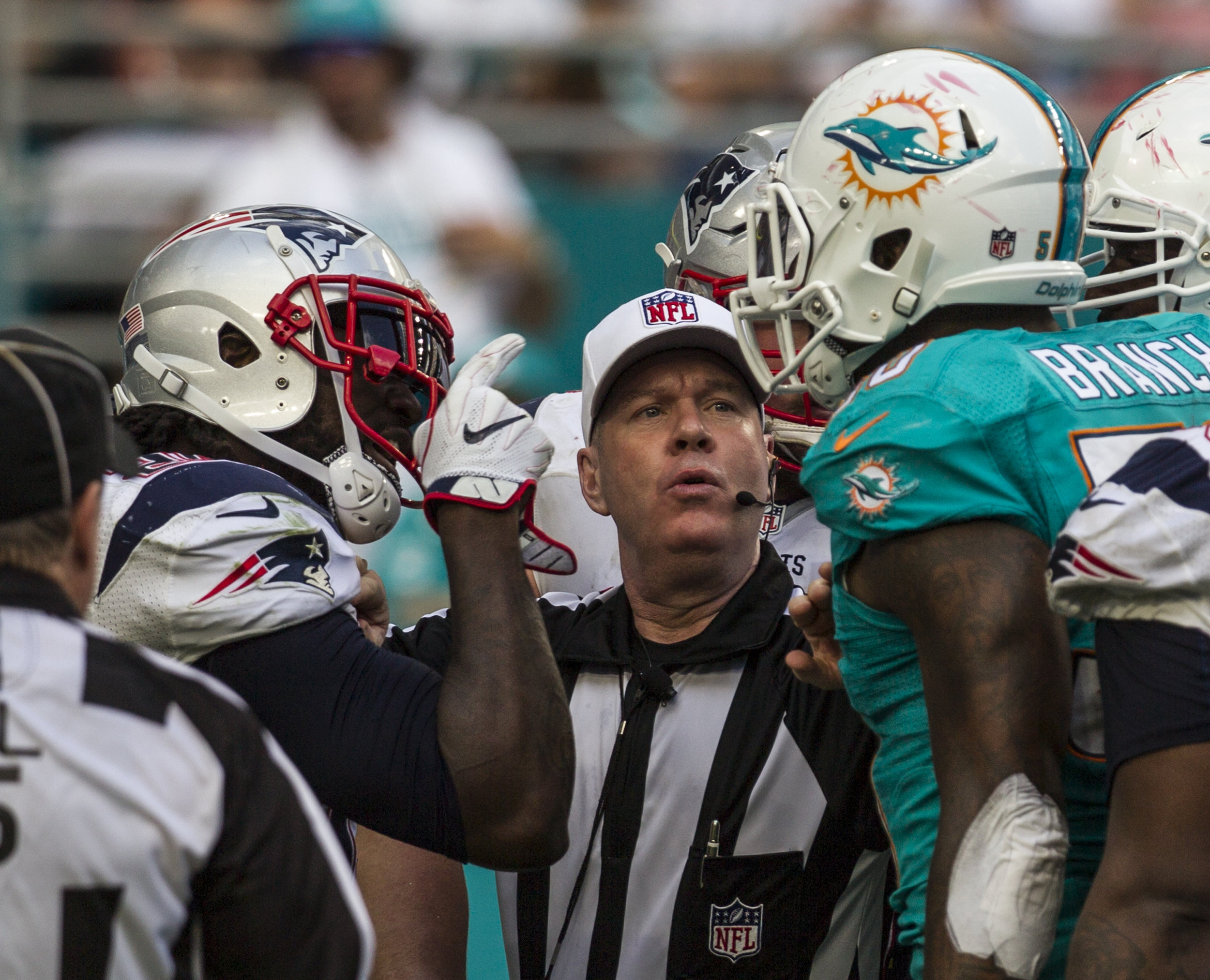 New England Patriots running back LeGarrette Blount argues with the Miami Dolphins defensive line after a play at Hard Rock Stadium in Miami Gardens, Florida, January 1, 2017.