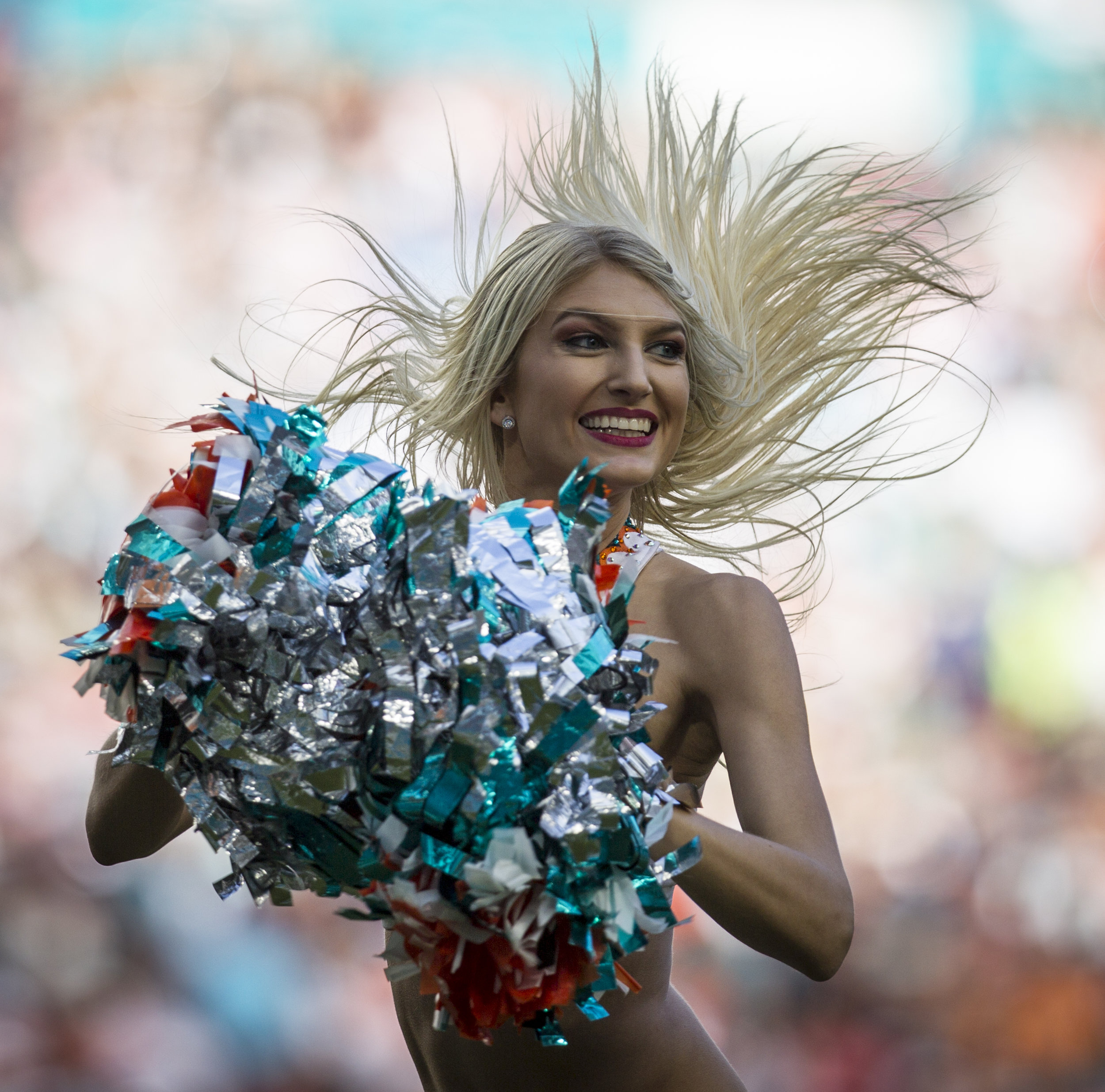 A Miami Dolphins cheerleader performs at Hard Rock Stadium in Miami Gardens, Florida, January 1, 2017.