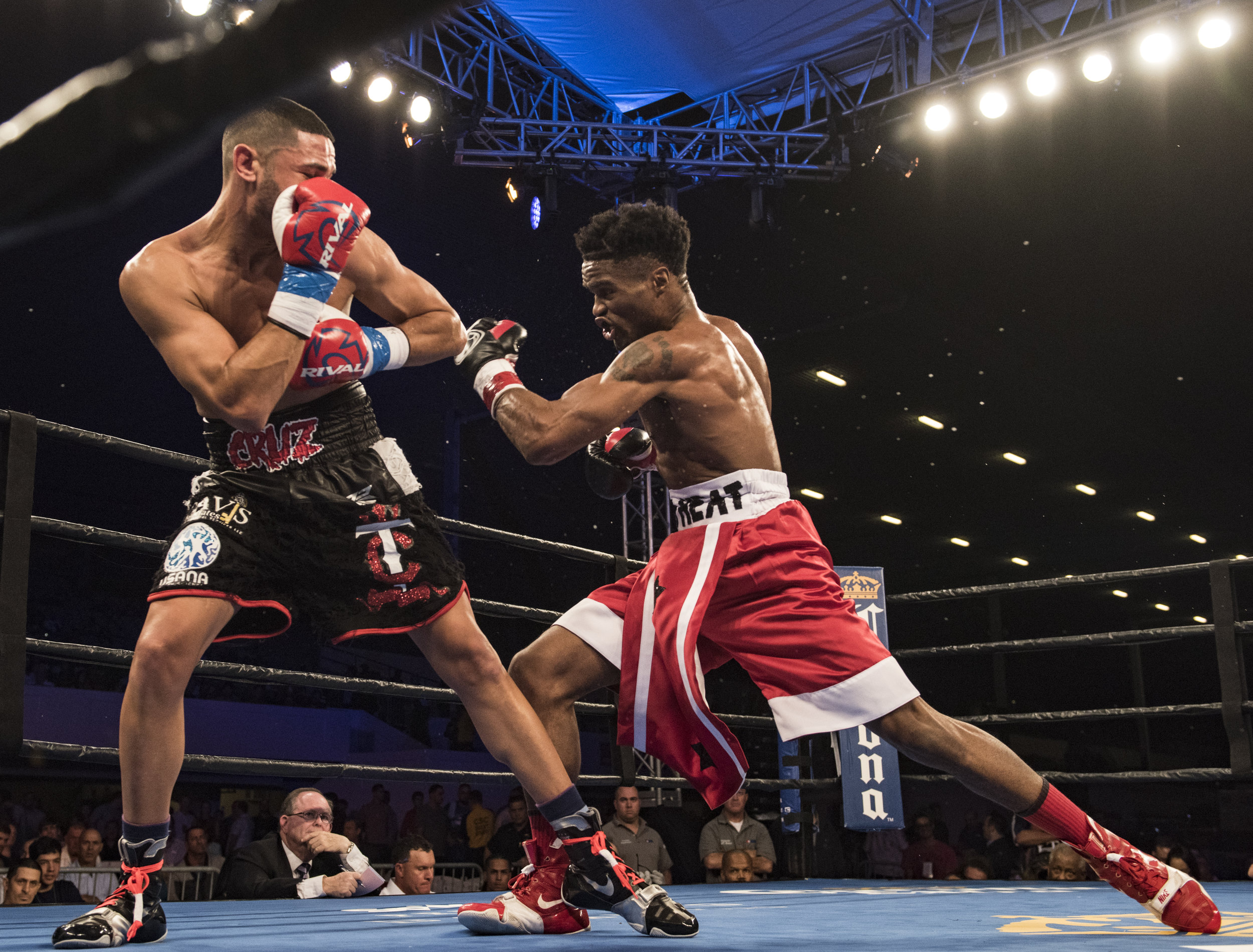 Alex Martin throws a hook in his fight against Robert Daniels Jr. at Hialeah Casino Park.